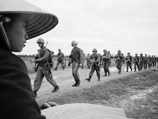 "Marines marching in Danang. March 15, 1965. ""The Vietnam"