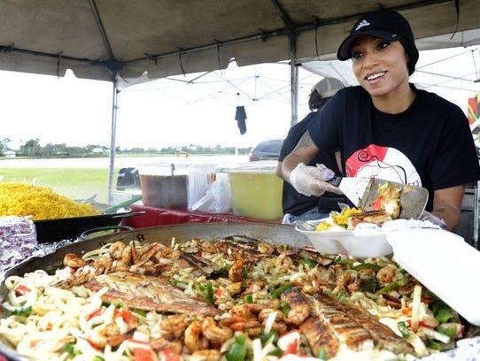 Alonna Foster of Chef Carmen Atlanta dishes out mahi-mahi