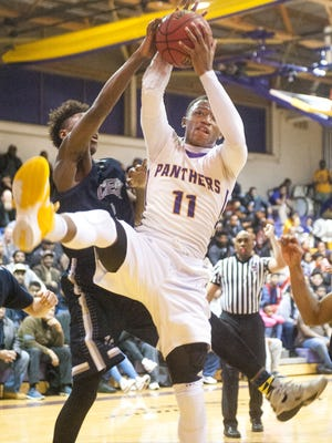 Camden's Jamal Holloway grabs a rebound next to Timber Creek's Caleb Bowser during Tuesday's game.