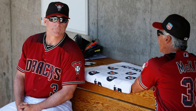 Diamondbacks manager Chip Hale talks with first base coach Dave McKay at Salt River Fields at Talking Stick on Friday, March 25, 2016.