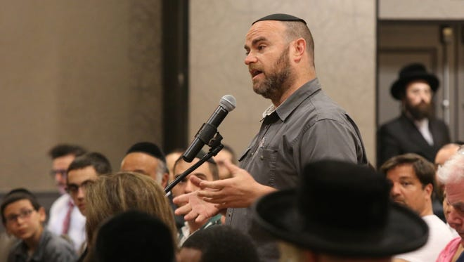Israel Greenwald speaks during special board meeting where trustees listen to the public comment on a controversial law banning overnight parking for the entire year at Crowne Plaza in Airmont July 5, 2016.