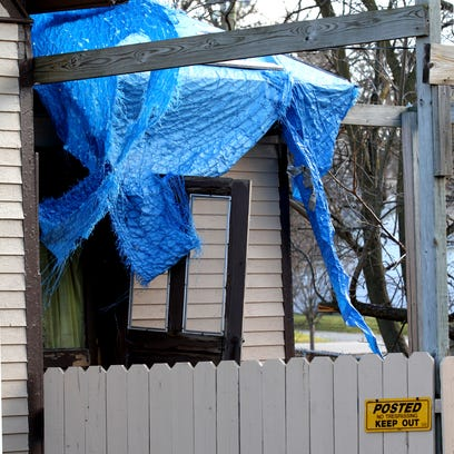 In this 2011 file photo, a tarp covers a side entrance