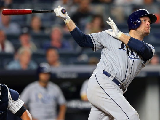Tampa Bay Rays first baseman Lucas Duda (21) follows through on a solo home run against the New York Yankees during the seventh inning at Yankee Stadium on Friday, July 28, 2017.