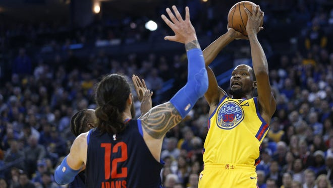 Golden State Warriors forward Kevin Durant (35) attempts a shot over Oklahoma City Thunder center Steven Adams (12) in the third quarter at Oracle Arena.