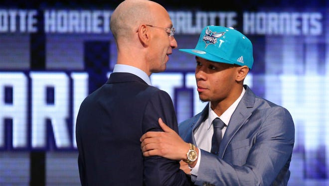 Shabazz Napier shakes hands with NBA Commissioner Adam Silver after being selected as the 24th overall pick to the Charlotte Hornets