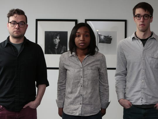 Contemporary Arts Center digital content manager Joshua Mattie, visitor experience coordinator Brittany Hargrave and communications and research assistant Chris Perbix pose with two Robert Mapplethorpe prints in the board room of the CAC. Hargrave wasn't born when the controversy  surrounding the Mapplethorpe exhibit occurred 1990, but on her first day at the CAC, she was shown the prints and told the story of the lawsuit.