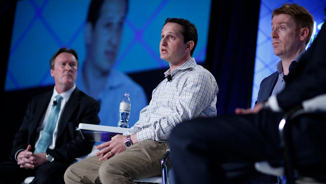 FILE - In this Sept. 29, 2015 file photo, Jason Robins, center, CEO of DraftKings website, speaks on a panel at the Global Gaming Expo in Las Vegas. Nevada regulators have ordered daily fantasy sports sites like DraftKings and FanDuel to shut down, saying they can't operate in the state without a gambling license. The state's Gaming Control Board issued a notice Thursday, Oct. 15, 2015, saying the sites must stop offering their contests to Nevada residents effective immediately.  (AP Photo/John Locher, File)