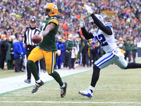 Green Bay Packers receiver Davante Adams scores a touchdown