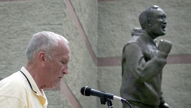 Former Moeller head coach Gerry Faust speaks at the dedication of a statue of himself at Moeller high school. photo by tony tribble