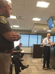 Macomb County Sheriff Anthony Wickersham listens as James Robertson discusses his study of the jail and the county's criminal justice system with county commissioners on May 11, 2017 at the county administration building in Mt. Clemens.