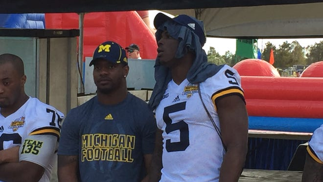"""Michigan freshman safety Jabrill Peppers looks on at the Citrus Bowl's """"Day for Kids"""" event Dec. 30, 2015."""