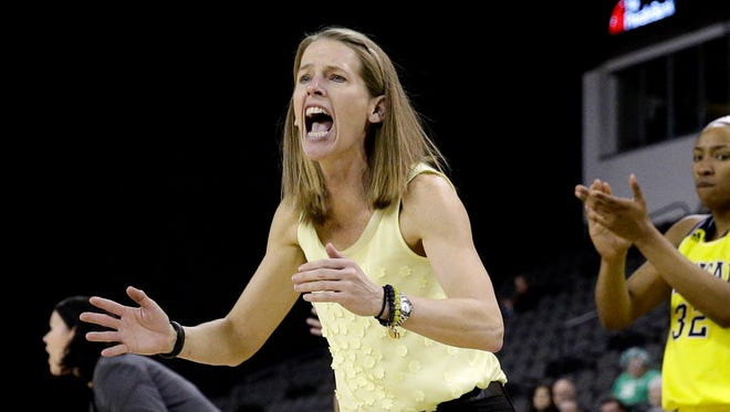 Michigan head coach Kim Barnes Arico yells to her team during the second half of an NCAA college basketball game against Michigan State in the Big Ten women's tournament in Hoffman Estates, Ill., on Thursday, March 5, 2015.