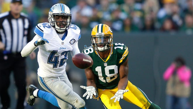 Green Bay Packers receiver Randall Cobb makes a catch in front of Detroit Lions safety Isa Abdul-Quddus at Lambeau Field.
