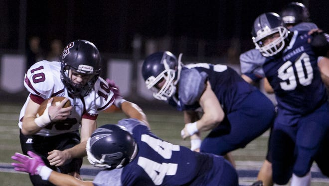 Boulder Creek quarterback Gunther Johnson is tackled during a game against Pinnacle in October.