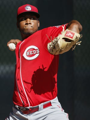 Reds pitcher Keyvius Sampson throws during a bullpen session at spring training Monday.