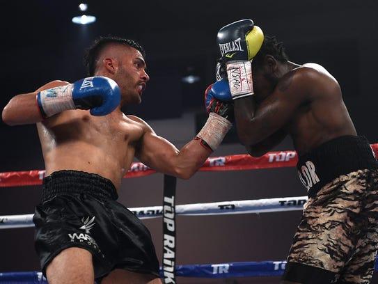 Reno's Santos Vasquez, left, takes on Anthony Taylor