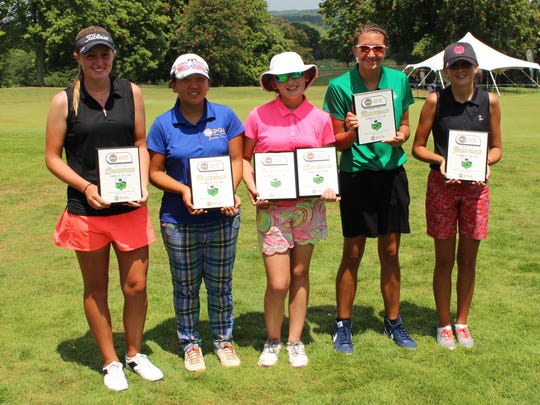 Nicole Adam (center) with some of the other placers after winning the girls 12-14 title in the PGA Junior Series tournament at Westbrook Country Club. At the far left is overall champ Megan Furtney of South Elgin, Illinois, and next to her is Tracy Lee, who tied for second overall with Adam, formerly of Lexington and now living in Pinehurst, North Carolina.