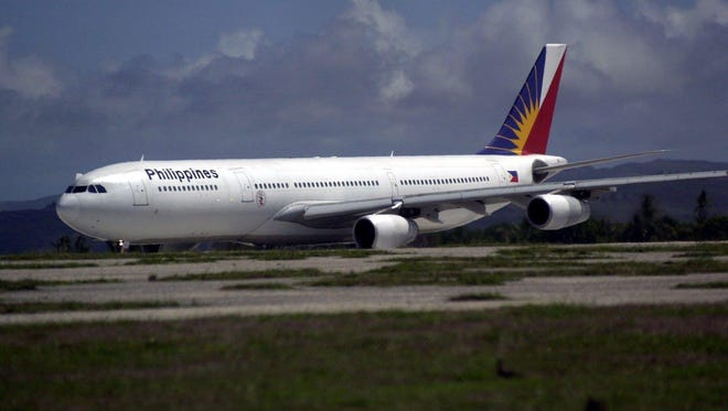 A Philippine Airlines aircraft gets ready to take off from Guam International Airport runways.
