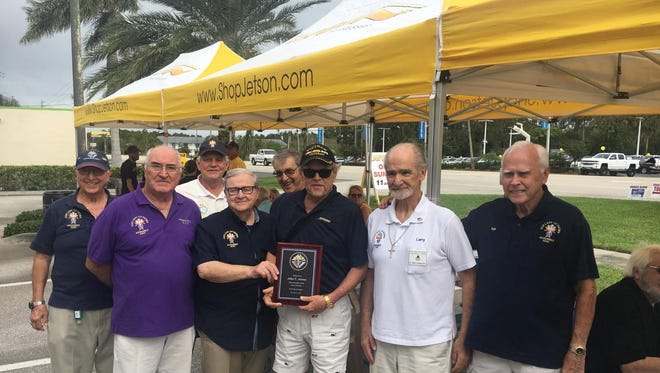 From left, Knights of Columbus Fourth Degree Knights Jim Pesh, Adriano Krecic, Tom Mollica, Tony Frasca, Tom Timmons, Larry D'Angelo and Ken Stewart present John Jetson, center, with a plaque for his legendary care for area veterans.