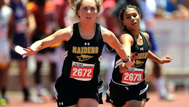Haskell's Kolbie Walker (2673) hands off to teammate Kara Stout (2672) on the third leg of the Class 2A girls 800m relay during the UIL State Track and Field Championships on Saturday, May 13, 2017, at Mike A. Myers Stadium in Austin.
