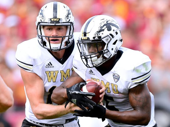 Western Michigan QB Jon Wassink, left, made his first