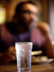 A glass of tap water with ice is shown as Mauro Zaccone, of Venice, Italy eats at Uncle Johns Pancake House in Toledo, Ohio Monday, Aug. 4, 2014. A water ban that had hundreds of thousands of people in Ohio and Michigan scrambling for drinking water has been lifted, Toledo Mayor D. Michael Collins announced Monday. (AP Photo/Paul Sancya)