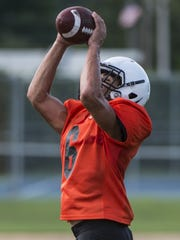 Palmyra's Peter Robertson moves from receiver to quarterback this season for the Cougars.