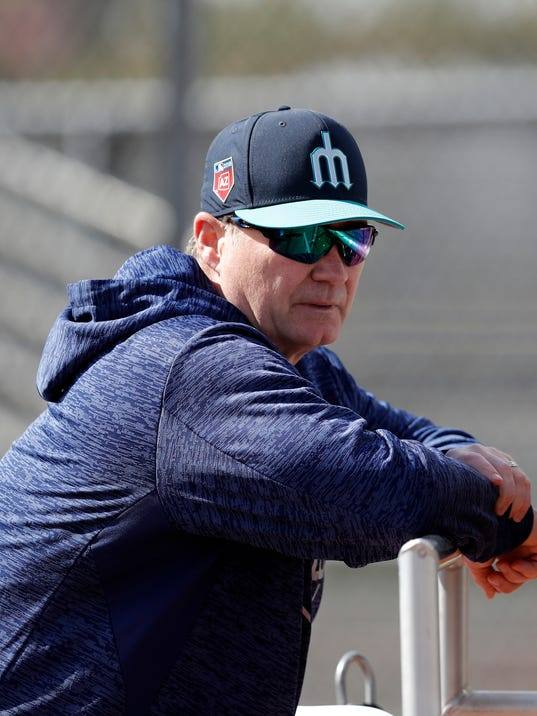 FILE - In this Feb. 19, 2018, file photo, Seattle Mariners manager Scott Servais watches batting practice during a baseball spring training workout in Peoria, Ariz. Seattle used a major league record 40 pitchers last season, causing constant headaches for Servais and his staff. (AP Photo/Charlie Neibergall, File)