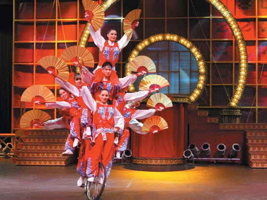 The Golden Dragon Acrobats perform using their bodies and simple props including everyday objects like plates, jugs, bicycles and umbrellas.