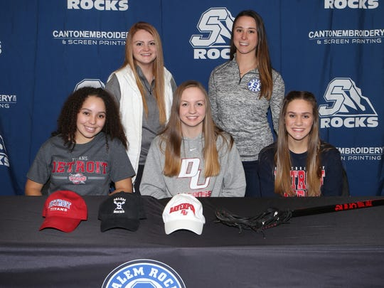Making their college choices official Wednesday were Salem girls lacrosse players (seated, from left) Maddie Johnson, Stephanie Miller and Leah Tardiff.