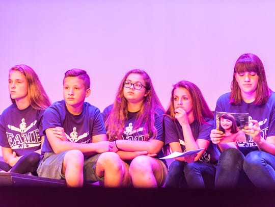 Campers wait to perform for Laura Osnes during the