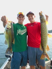 Josh and Ben Rollins hold up a pair of nice fish caught