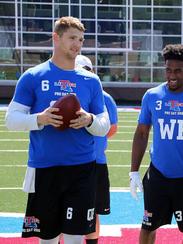 Louisiana Tech quarterback Jeff Driskel, left, talks