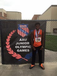 Angelo Grose shows off his gold medal after winning