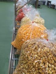 Bags of popcorn don't sit long in the Faris Gourmet