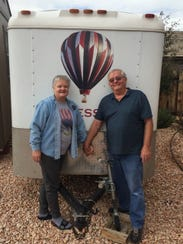 Steve and Ingrid Martell stand in front of their balloon