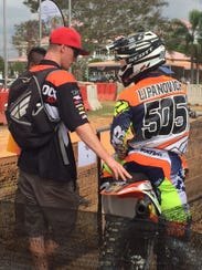 In this file photo, mechanic Ray Obermeyer has a conversation with Sean Lipanovich during the FIM Asian Motocross Championship, Round 1 and 2 in Kuala Terengganu, Malaysia.