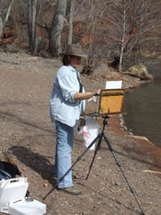 Pam Flanders paints during the Plein Air art event