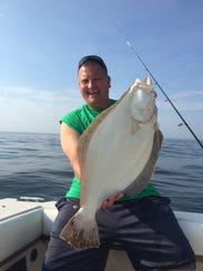 Eddie Goodell Jr. of Wall, holds the 7-pound fluke