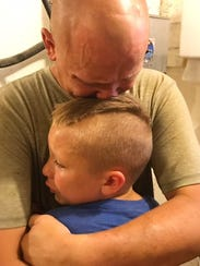 Weston and his young son share tears as they milk their