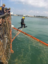 A Navy diver looks for sailors missing after the collision