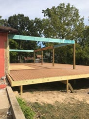 El Azteco West is building a patio on the east side