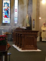A dedication ceremony is held for the new altar at