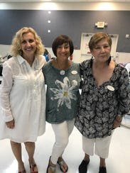 Attending the summer planning meeting were Carole Romano,