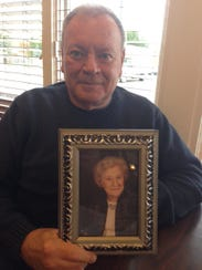 Gary Kudron, of Livonia, holds a photo of his mother,