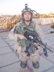 Spc. Yauo Yang was deployed with the Wisconsin National