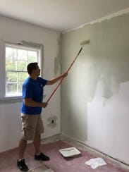 Volunteers painted the rooms in the dormitory, which