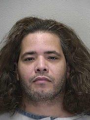 A mugshot of Bryan Lopez taken May 5, 2013 after he