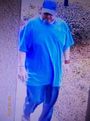 A surveillance photo of a man believed to be a suspect