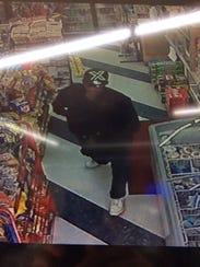 Suspected armed robber in the Patton Avenue Sunoco.
